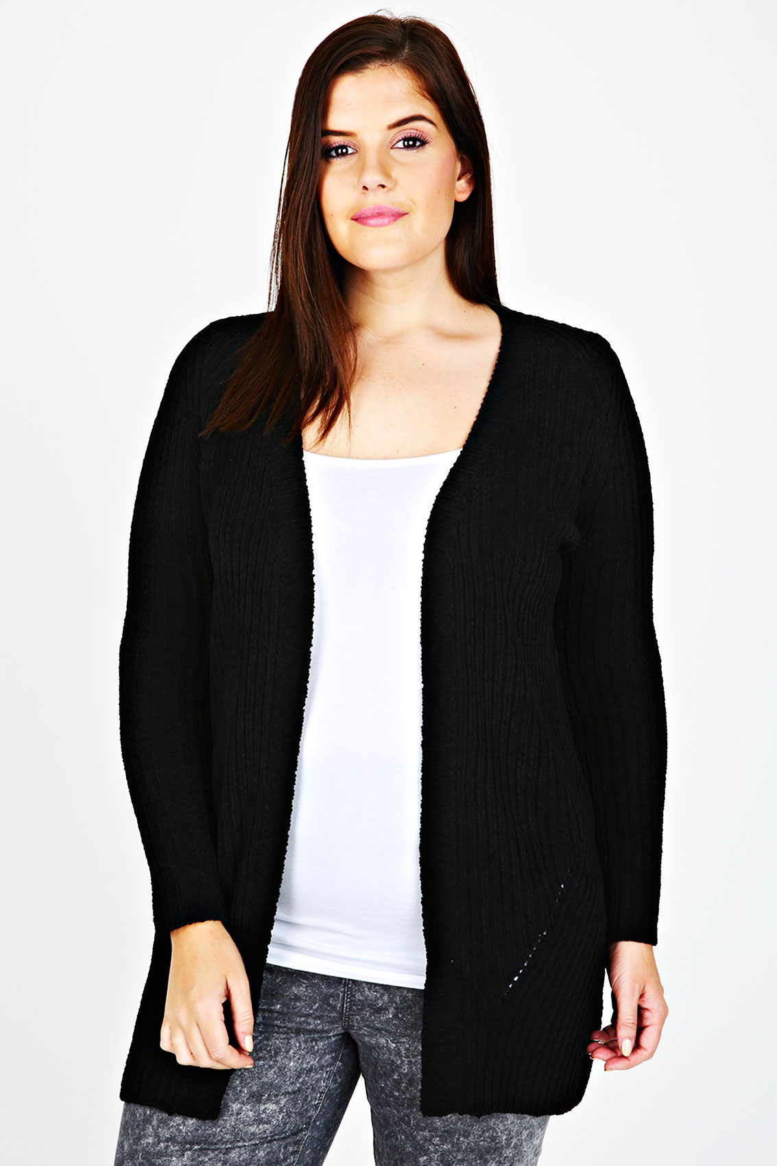 A slightly oversized black sweater with a longline length, open front, and roomy pockets. Shop rue21!