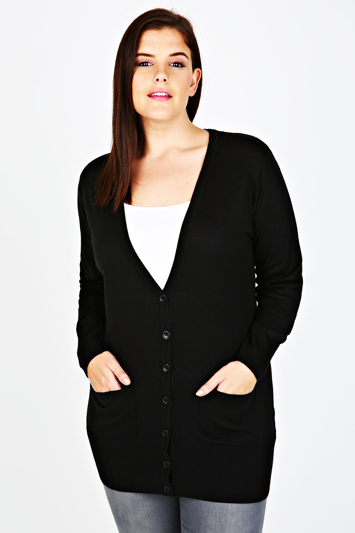 The standard boyfriend cardigan has been reimagined with a sexy twist. This black soft knit cardigan has sexy lace-up detail along the sleeves for a mock cold shoulder look.
