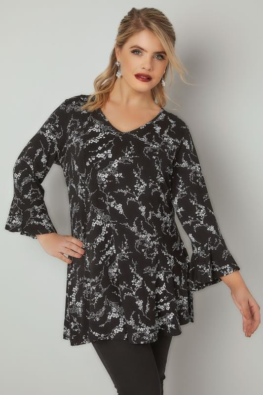 Plus Size Jersey Tops Black & White Floral Print Peplum Top With Flute Cuffs