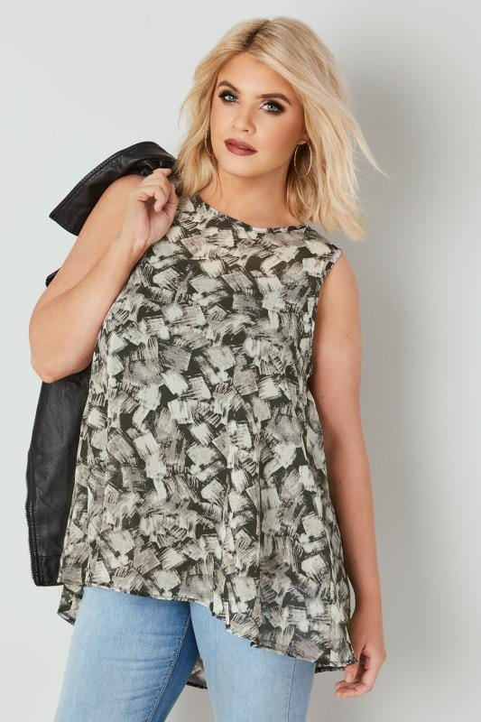 Black & White Sleeveless Woven Top With Dipped Hem