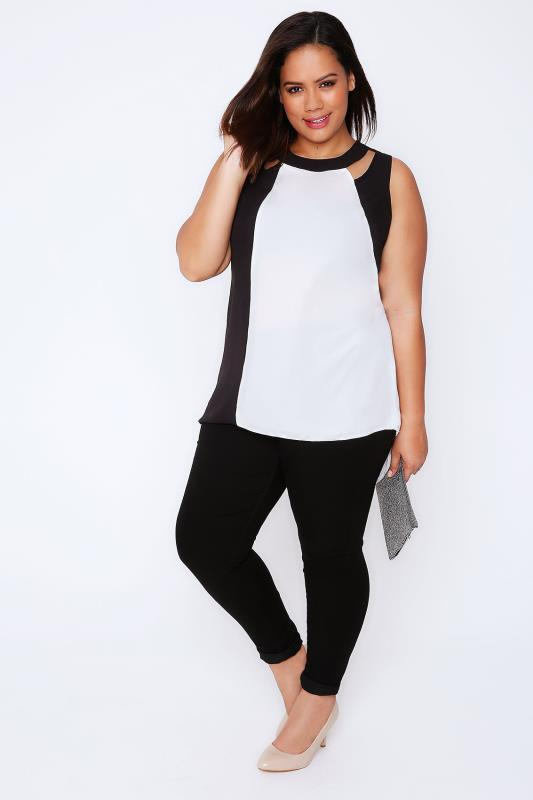White & Black Colour Block Sleeveless Top With Cut Out Details