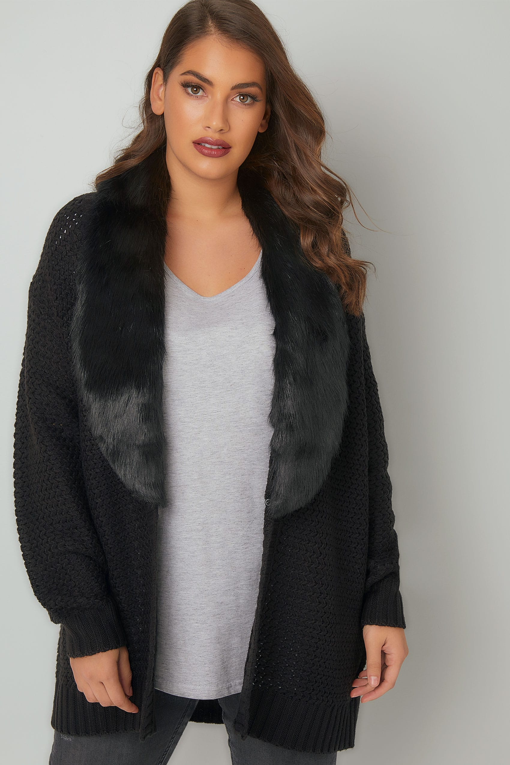 Fine gauge V-neck cardigan topped with a removable faux fur collar. % Rayon. Hand wash or dry clean. Imported. Close stretch fit. Wear with the faux fur collar or without for a classic V-neck silhouette. Collar attaches with buttons. Silvertone snaps close the ribbon-lined placket. 3/4-length sleeves. Ribbon-covered neck seam.