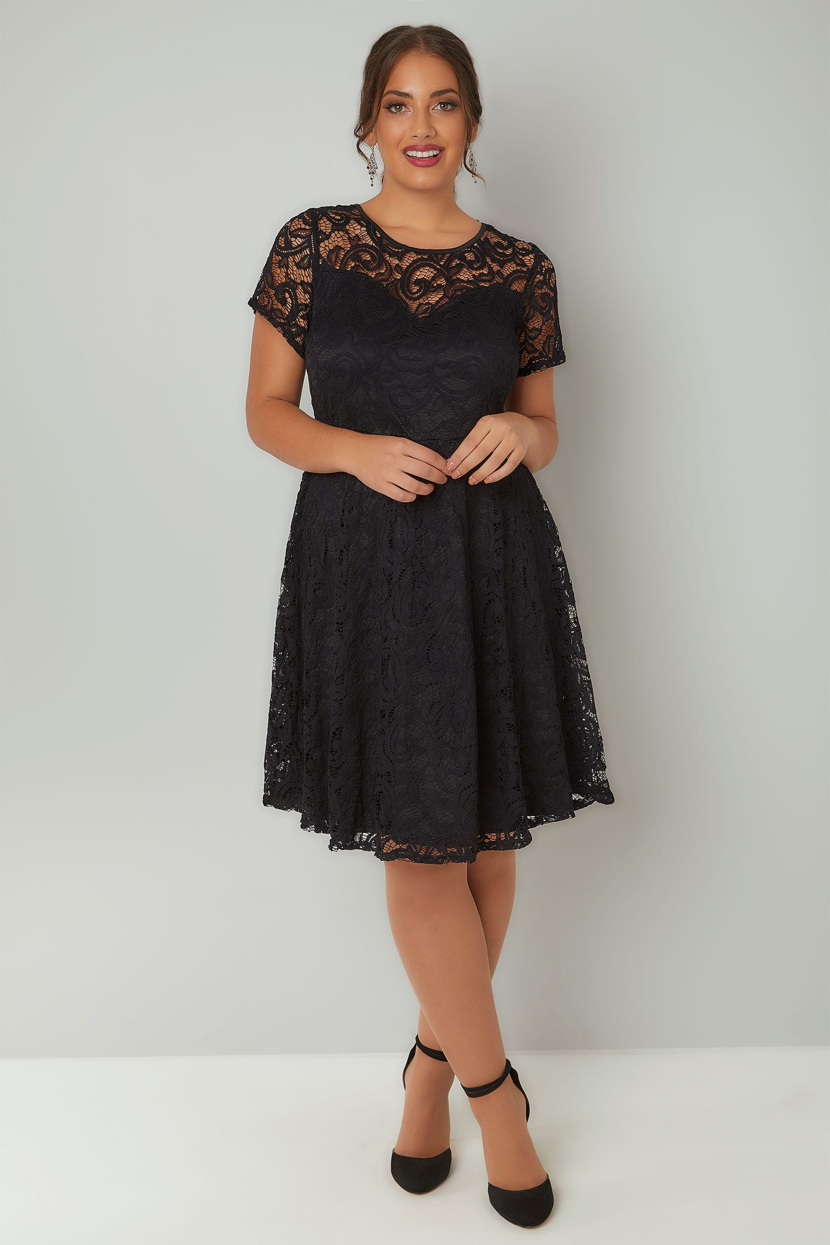 Black Floral Jersey Knit Skater Dress Description: A banded stretch waist nips you in as flutter sleeves and a flared handkerchief hem adds movement to this wrinkle-free mini dress.