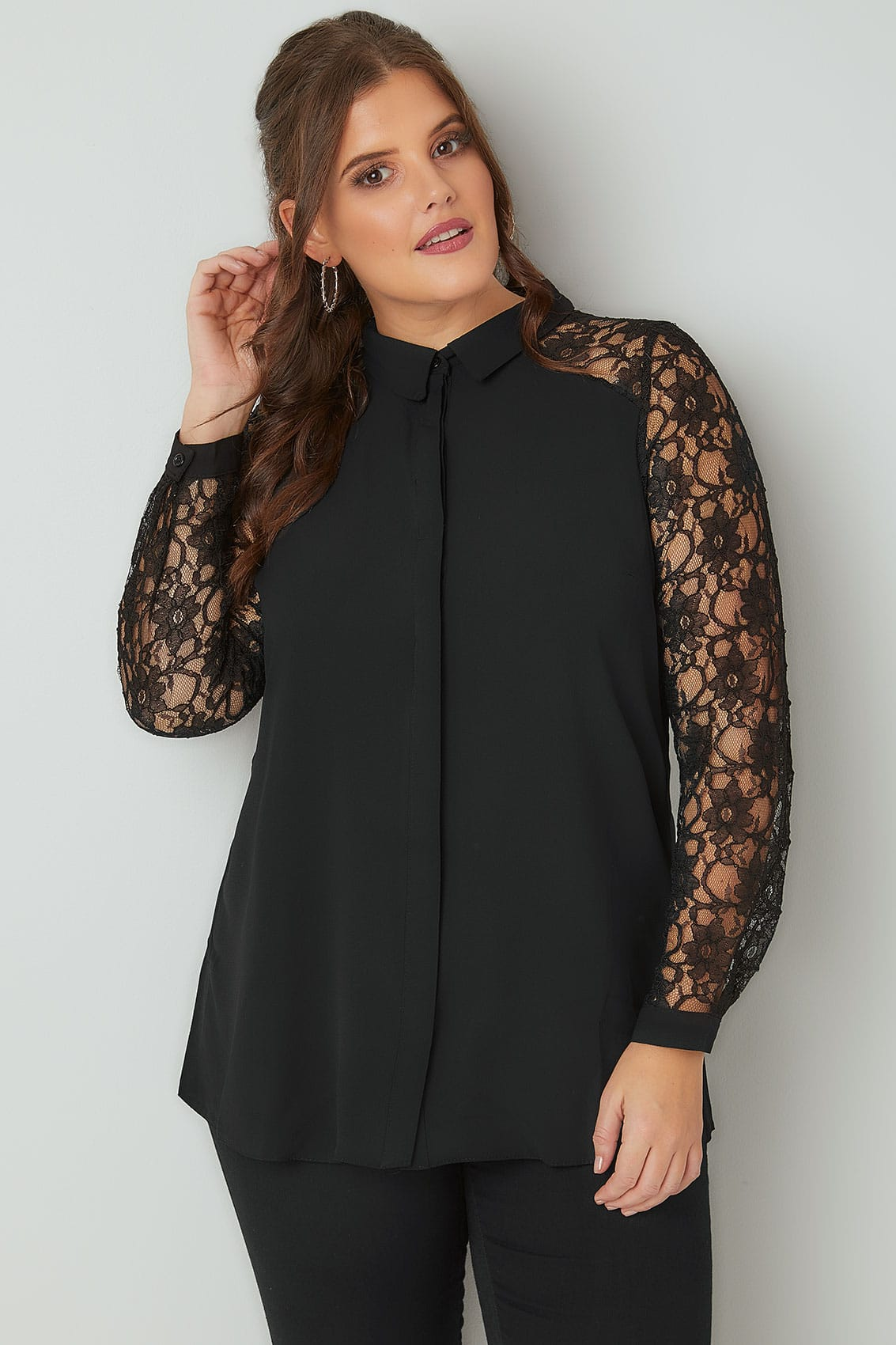For a look that's indulgently luxe (and feels fabulous), this day-to-night shirt is la crème de la crème. The bodice and back are lightweight and polished, while this design's long sleeves are elaborated with gorgeous, contrasting lace. Individual style. Clean, modern lines. The Exclusive Black Label by Chico's™ collection. Lightweight fabric.