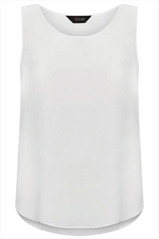 White Sleeveless Top With Curved Dipped Hem