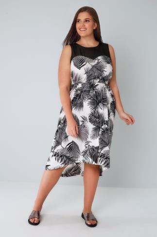 Midi Dresses Black & White Palm Print Dress With Sweetheart Neckline & Hi Lo Hem 136088