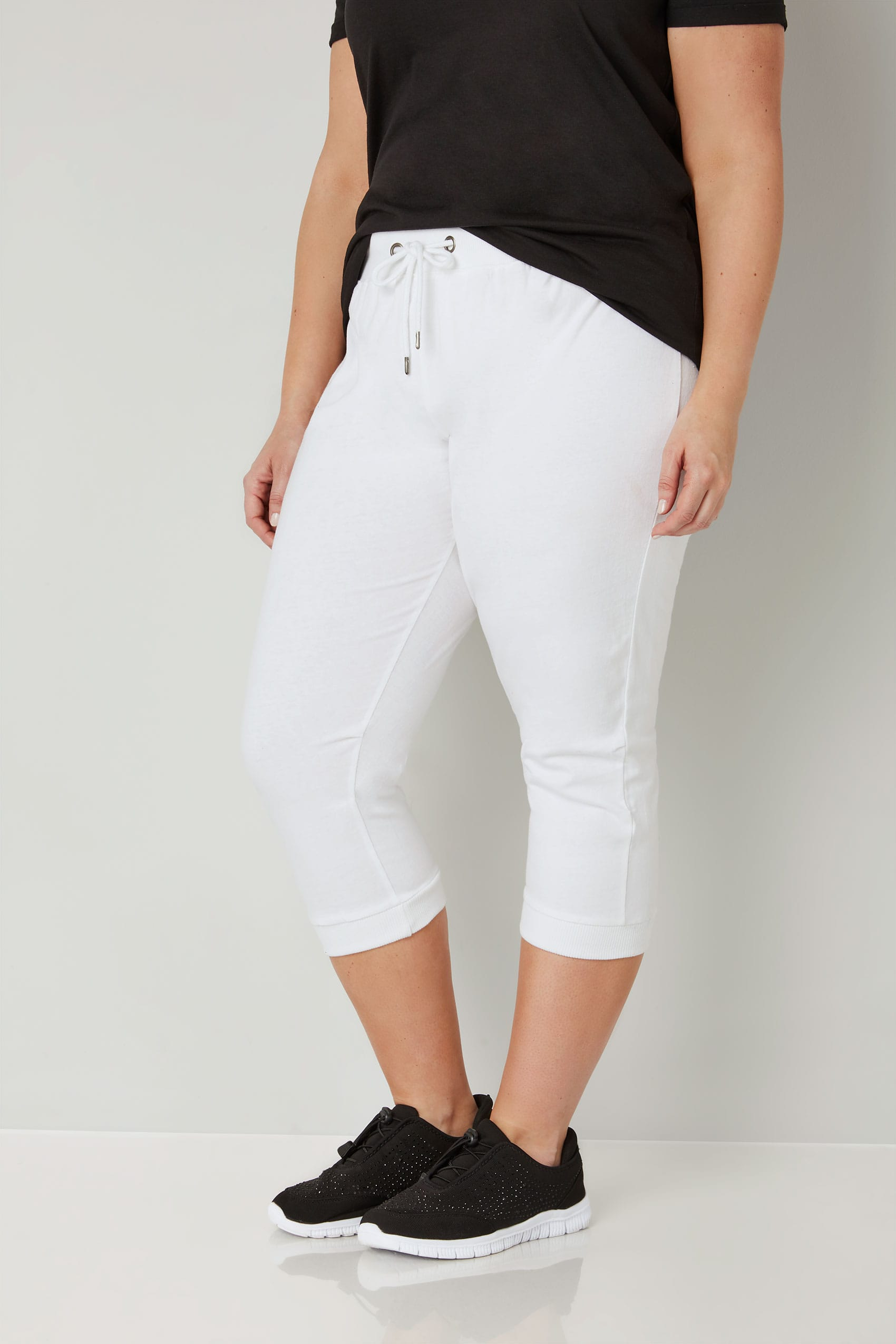White cropped joggers with elasticated waistband plus for Buy here pay later