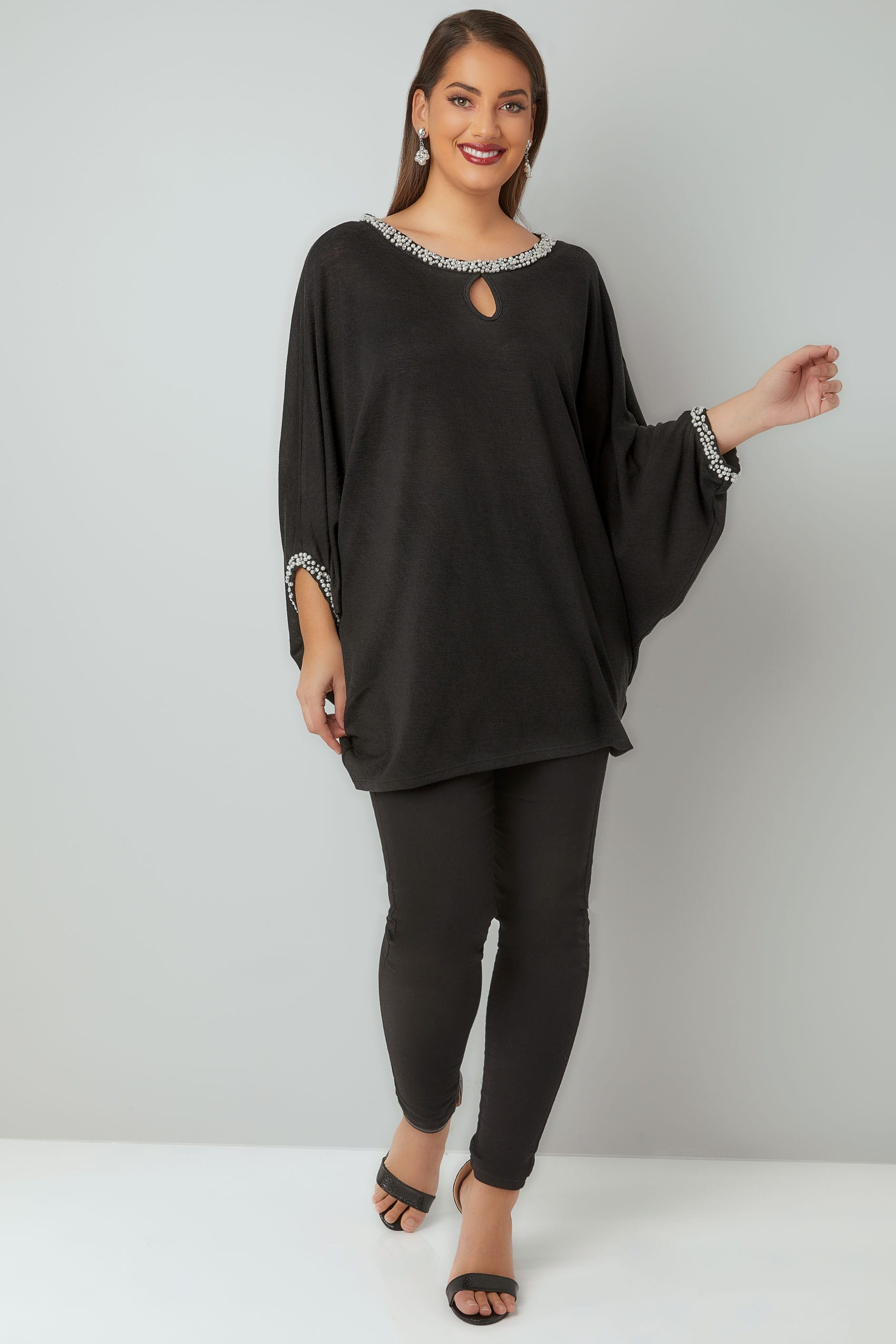 Knitting Lessons London : Black fine knit cape top with faux pearl diamante trim